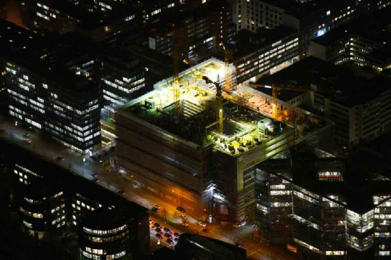 Night lighting construction site to build a new office and commercial building of ' Olympus Campus ' on Heidenkonpsweg - Wendenstrasse in Hamburg, Germany