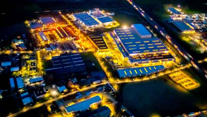 Night lighting building and production halls on the premises of Claas Service ond Parts GmbH on Kronstrasse in the district Uentrop in Hamm in the state North Rhine-Westphalia, Germany. Further information at: CLAAS KGaA mbH.