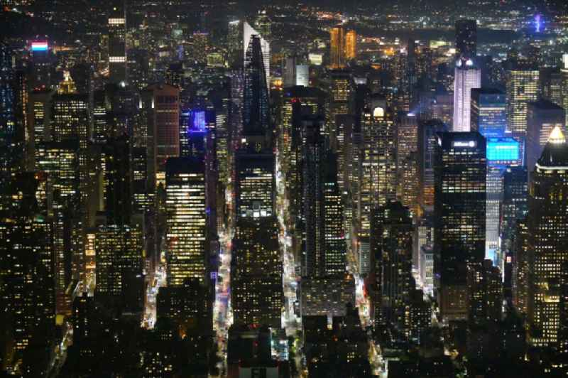 Night lighting High-rise ensemble in the district Manhattan in New York in United States of America