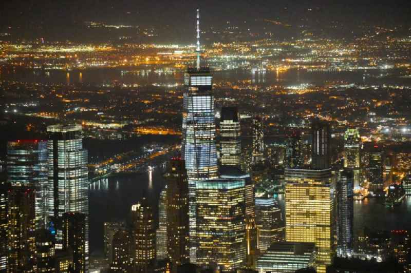 Night lighting City center with One World Trade Center in the skyline in the downtown area in the district Manhattan in New York in United States of America