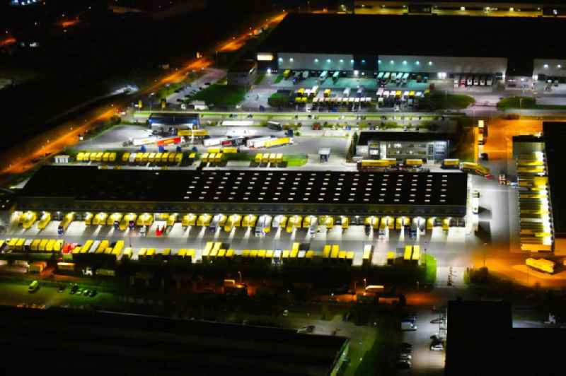 Night lighting building complex and distribution center on the site of DACHSER SE An den Gehren in Schoenefeld in the state Brandenburg, Germany. Further information at: DACHSER SE.