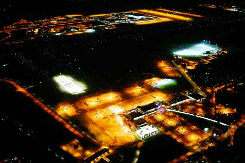 Night lighting Runway with hangar taxiways and terminals on the grounds of the airport Berlin-Schoenefeld in Schoenefeld in the state Brandenburg, Germany