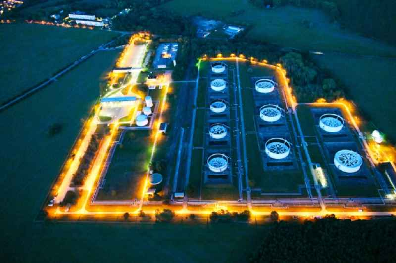 Night lighting mineral oil - high storage tanks for gasoline and diesel fuels in Seefeld in Brandenburg