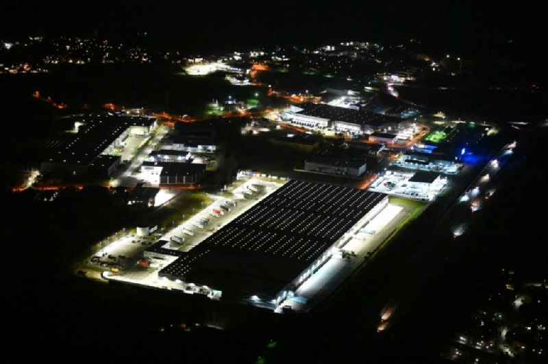 Night lighting warehouses and forwarding building 'LIDL Zentrallager Siek' on Jacobsrade in the district Meilsdorf in Siek in the state Schleswig-Holstein, Germany