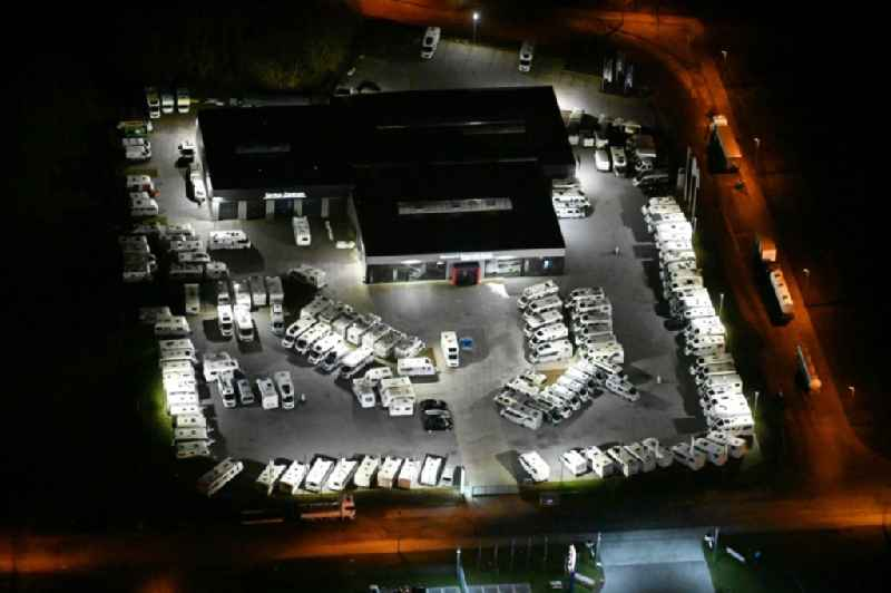 Night lighting car dealership building for RVs 'Caravan & Reisemobil Center Reinfeld GmbH & Co. KG' on Stubbendorfer Ring in the district Stubbendorf in Wesenberg in the state Schleswig-Holstein, Germany