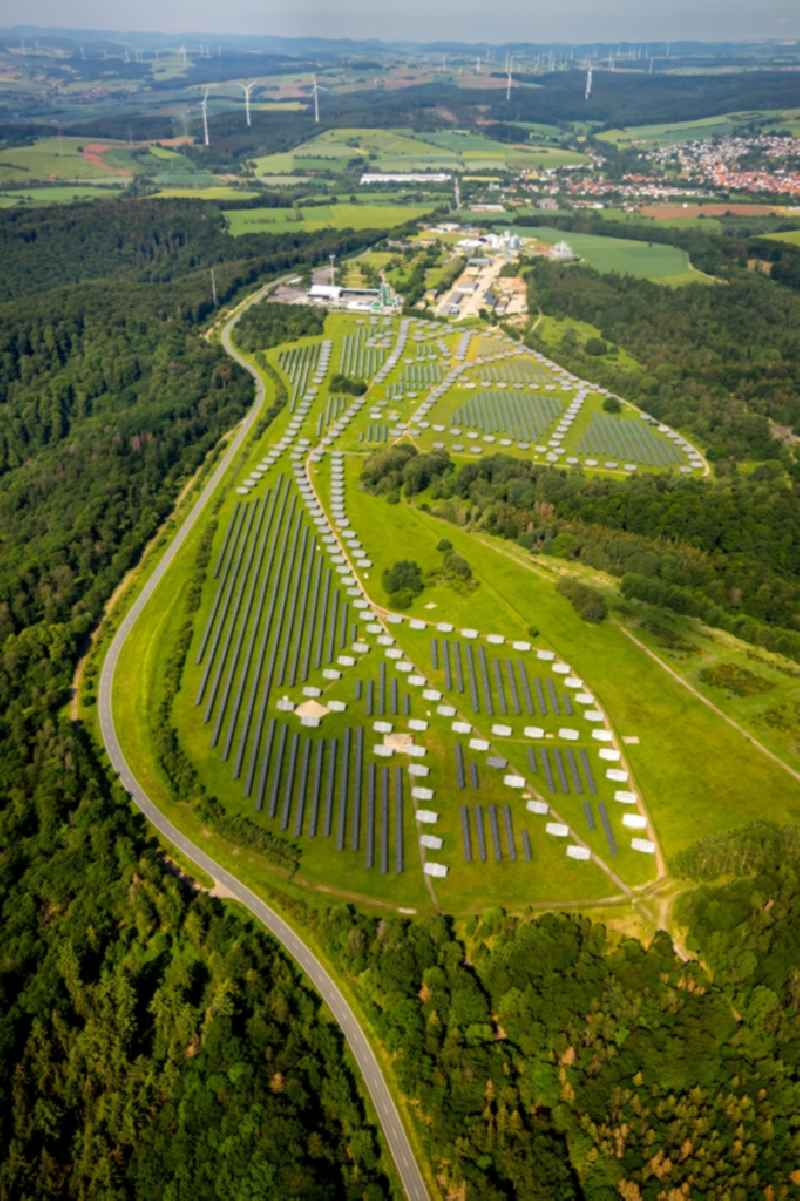 Panel rows of photovoltaic and solar farm or solar power plant on the former Gelaende of Prinz-Eugen-Kaserne in Bad Arolsen in the state Hesse, Germany