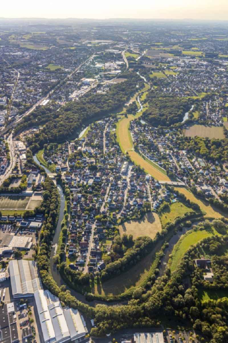Curved loop of the riparian zones on the course of the river Weser with residential area of a single-family housing estate in Bad Oeynhausen in the state North Rhine-Westphalia, Germany