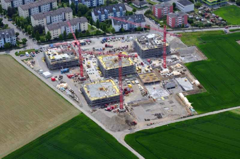 Construction site 'Neumatt-Stein' to build a new multi-family residential complex on Muenchwilerstrasse - Schaffhauserstrasse in Stein in the canton Aargau, Switzerland. Further information at: ERNE AG Bauunternehmung,  FORTIMO AG,  Redinvest Immobilien AG,  Rhomberg Bau AG.