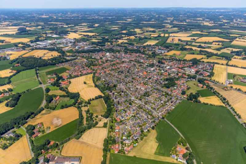 Village - view on the edge of agricultural fields and farmland in Beelen in the state North Rhine-Westphalia, Germany
