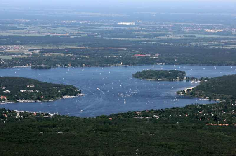 Riparian areas on the lake area of with Sailboot - regatta in the district Wannsee in Berlin