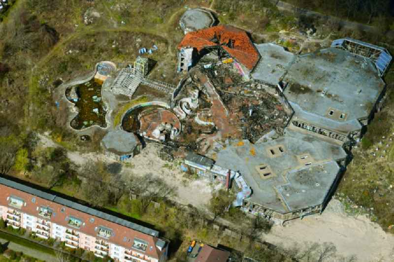 Ruins of the decaying land with the building of the closed water park in the district Blub Berlin Tempelhof