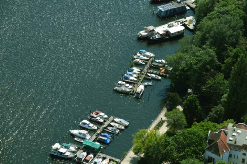 Pleasure boat marina with docks and moorings on the shore area of Spree River in the district Niederschoeneweide in Berlin, Germany