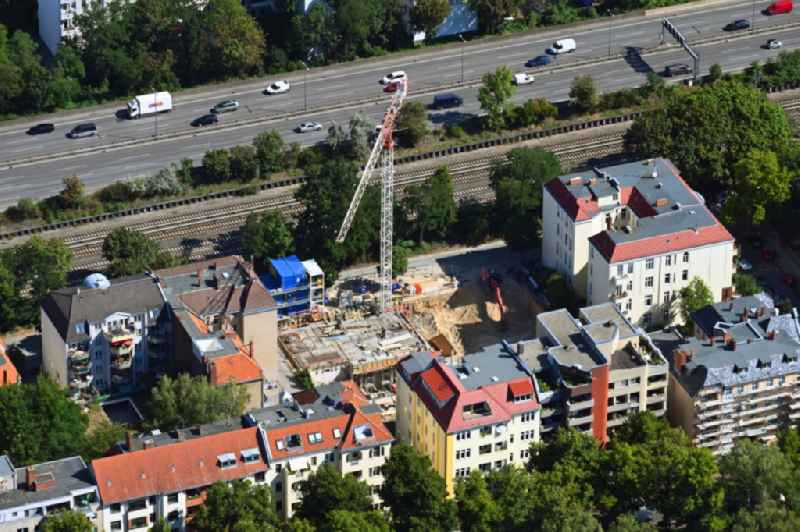 Construction site for the multi-family residential building ' Maison VIKTORIA ' on Varziner Strasse - Stubenrauchstrasse in the district Friedenau in Berlin, Germany
