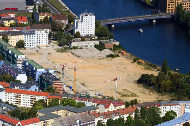 Construction site to build a new multi-family residential complex Fliessstrasse - Hasselwerder Strasse on river Spree in the district Schoeneweide in Berlin, Germany
