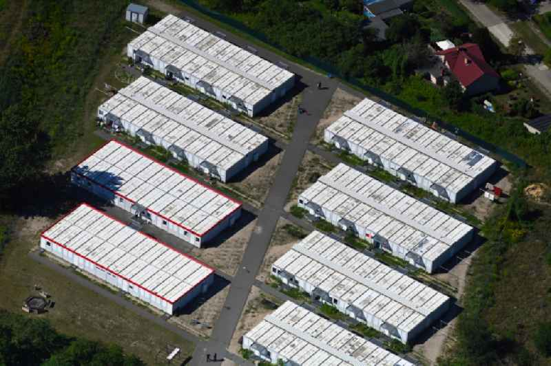 Container settlement as temporary shelter and reception center for refugees between Molchstrasse and Quittenweg in the district Altglienicke in Berlin, Germany