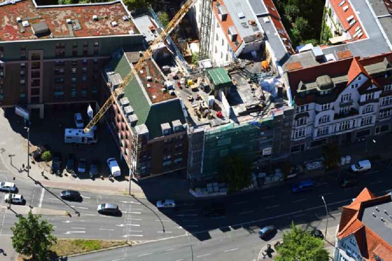 Construction site for reconstruction and modernization and renovation of a building with the construction of a new roof on Schlossstrasse in the district Steglitz in Berlin, Germany