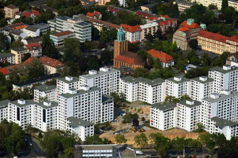 Skyscrapers in the residential area of industrially manufactured settlement on Rathausstrasse overlooking the church building of the 'Martin-Luther-Gedaechtniskirche' in the district Mariendorf in Berlin, Germany