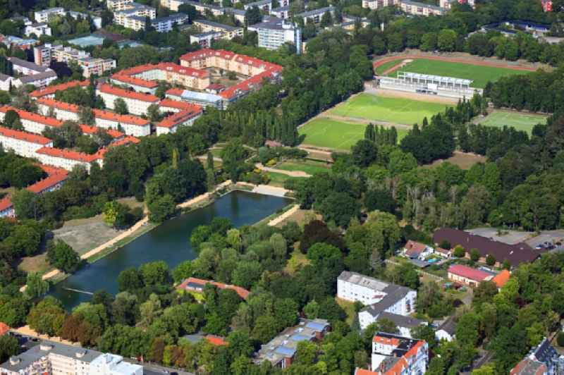 Park of the Volkspark Mariendorf with ponds of the Bluemelteich and sports field ensemble on Pruehssstrasse in the district Mariendorf in Berlin, Germany
