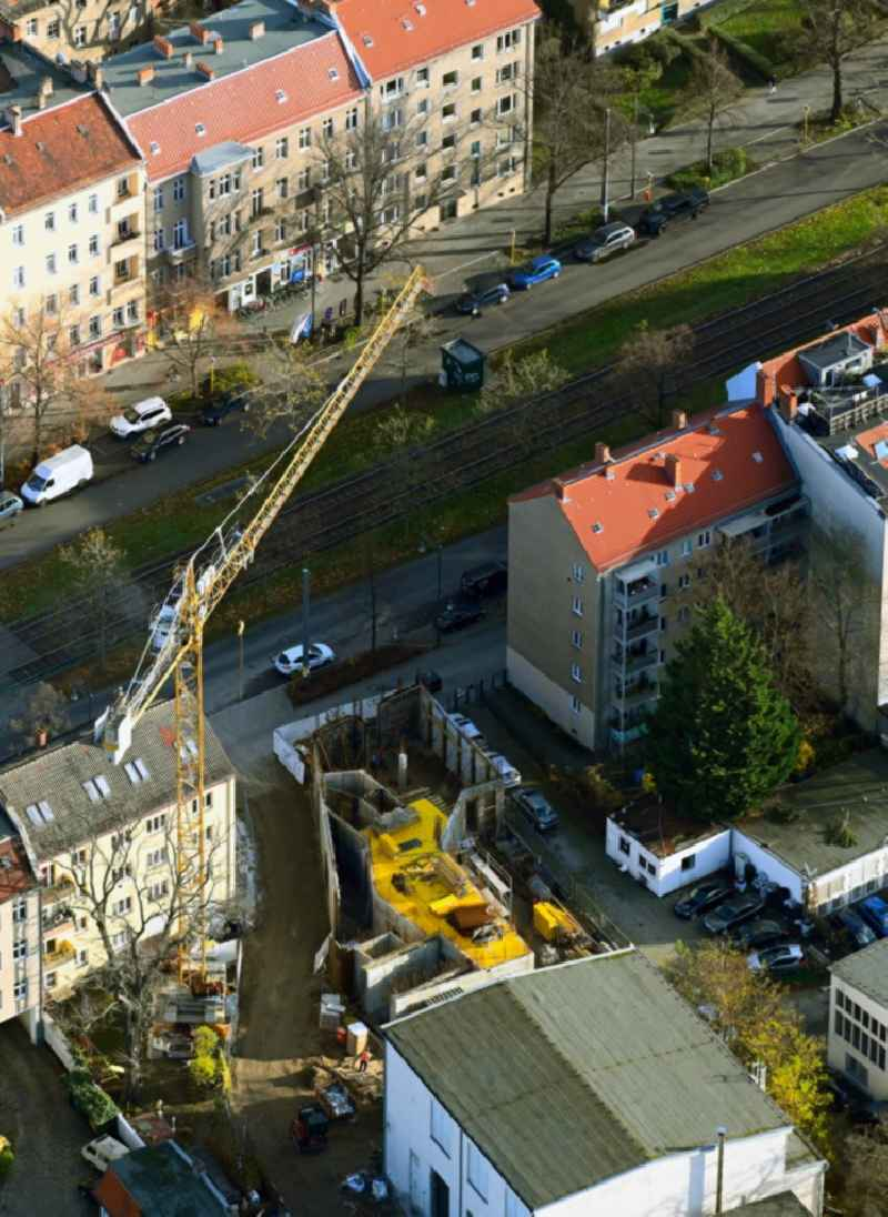 Construction site for the construction of gaps along the multi-family house residential housing estate Berliner Strasse in the district Pankow in Berlin, Germany