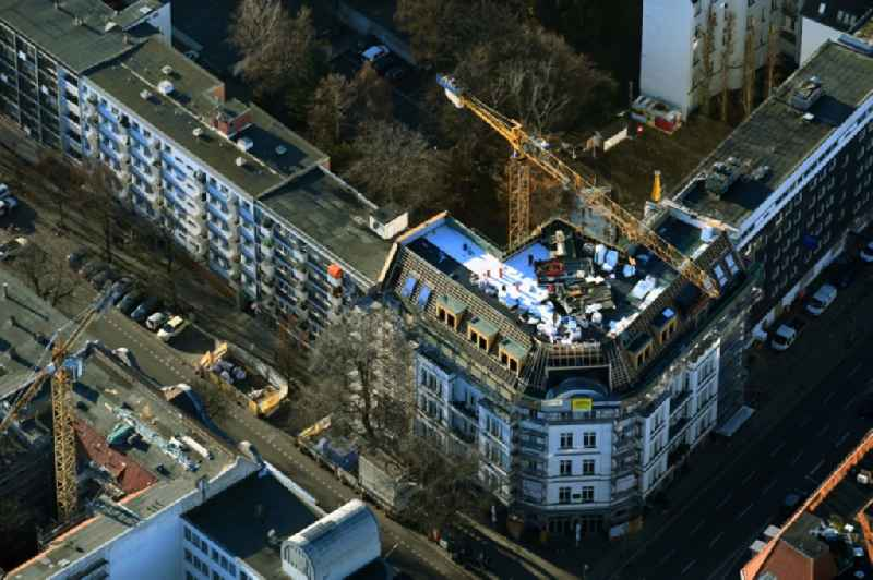 Construction site for reconstruction and modernization and renovation of a residential - commercial building on Lietzenburger Strasse corner Uhlandstrasse in the district Charlottenburg in Berlin, Germany