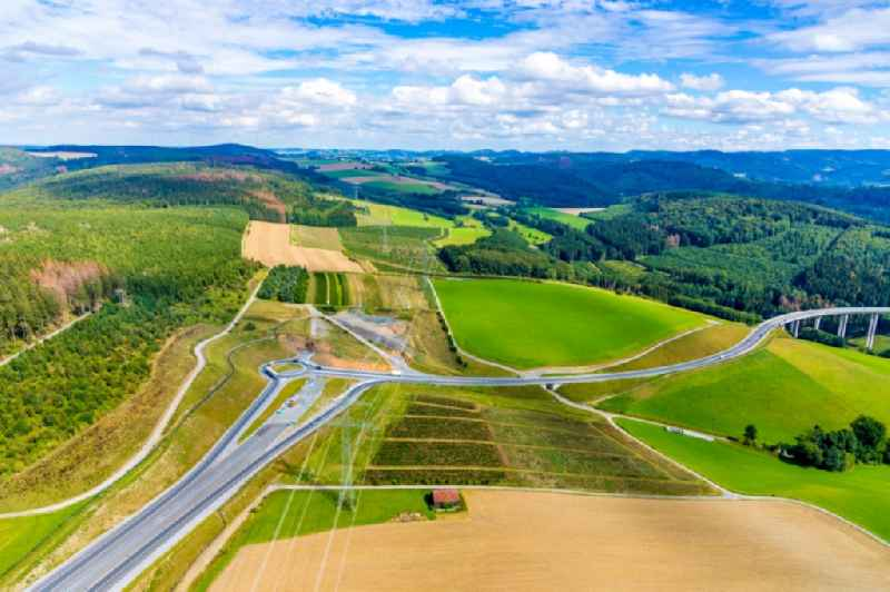 Construction site of routing and traffic lanes during the highway exit and access the motorway A 46 with Kreisverkehr and Anschluss on Bandesstrasse B7 in the district Olsberg in Bestwig in the state North Rhine-Westphalia, Germany