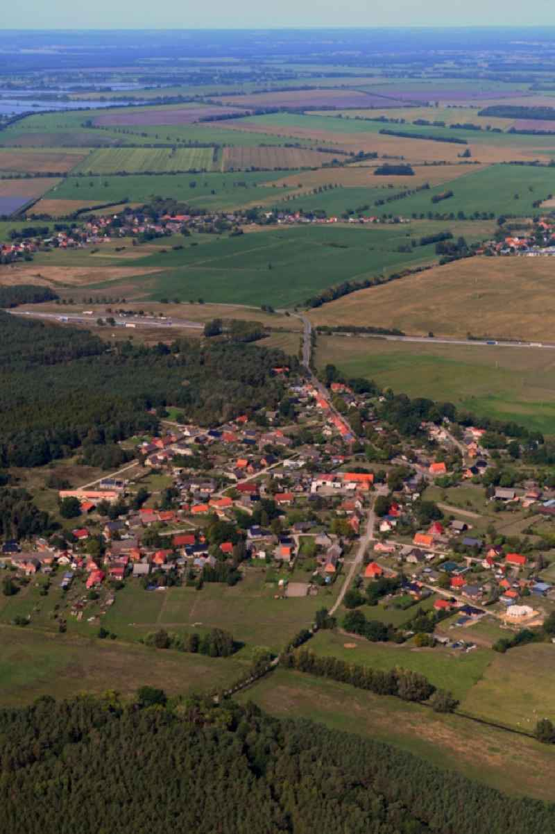 Village - view on the edge of forested areas in Blievenstorf in the state Mecklenburg - Western Pomerania, Germany