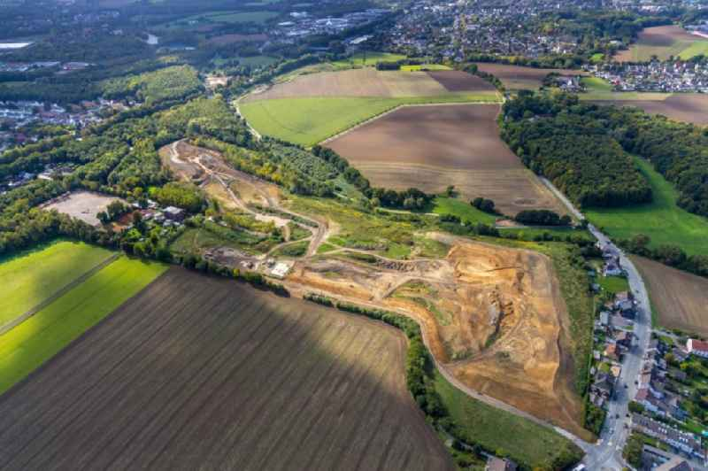 Construction site with development, foundation, earth and landfill works for the new building of a golfpark and the renovation of a sports ground along the Noerenbergstrasse in Bochum in the state North Rhine-Westphalia, Germany.