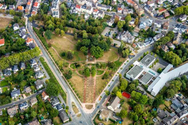 Building site for the construction and layout of a new park with paths and green areas of the 'Parkanlage Ehrenmal' on Bahnhofstrasse - Bussmanns Weg in the district Wattenscheid in Bochum in the state North Rhine-Westphalia, Germany