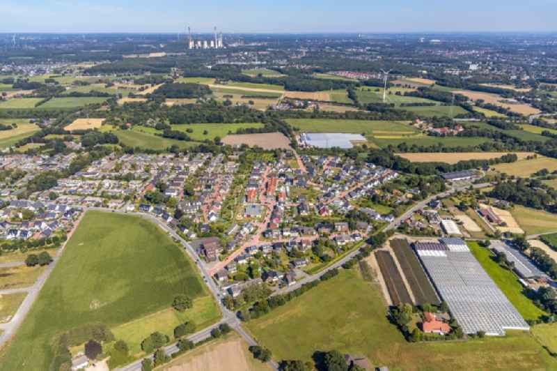 City view from the downtown area with the outskirts with adjacent agricultural fields between Dorfheide and Rentforter Strasse in the district Kirchhellen in Bottrop in the state North Rhine-Westphalia, Germany
