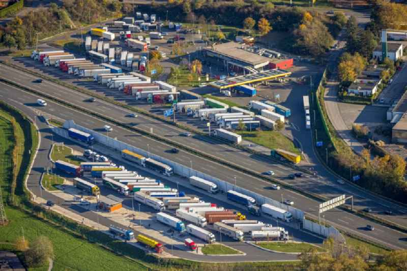 Lorries - parking spaces at the highway rest stop and parking of the BAB A 2 in the district Fuhlenbrock in Bottrop in the state North Rhine-Westphalia, Germany
