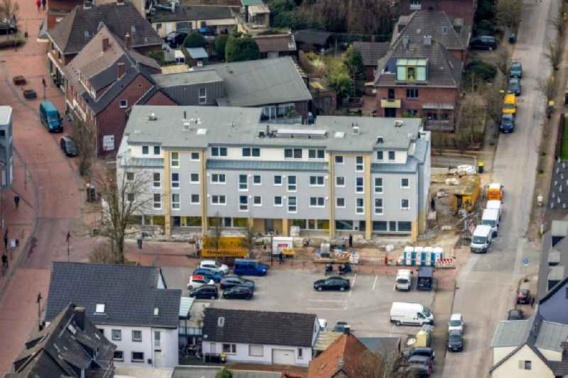 New construction of a residential and commercial building of 'Kirchhellener Arkaden' on Schulstrasse corner Kirchstrasse in the district Kirchhellen in Bottrop in the state North Rhine-Westphalia, Germany