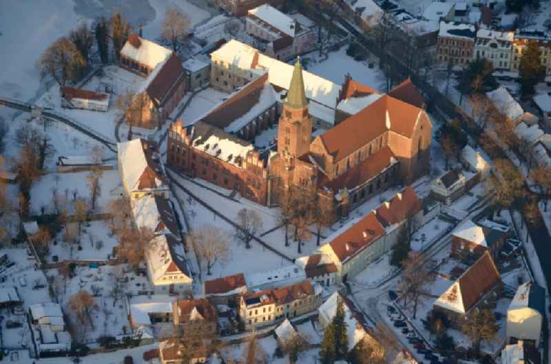 Wintry snowy church building of the cathedral of ' Dom ' in Brandenburg an der Havel in the state Brandenburg, Germany