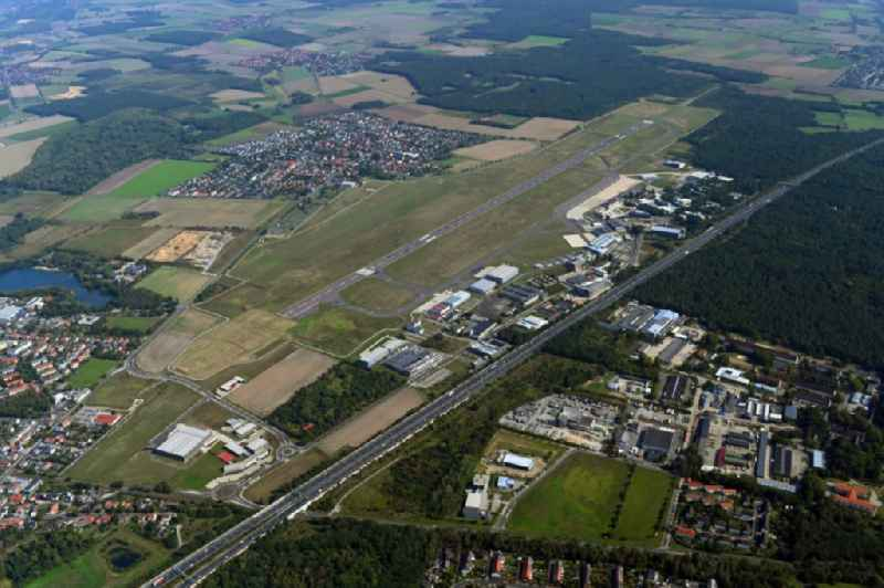Runway with hangar taxiways and terminals on the grounds of the airport in the district Waggum in Brunswick in the state Lower Saxony, Germany