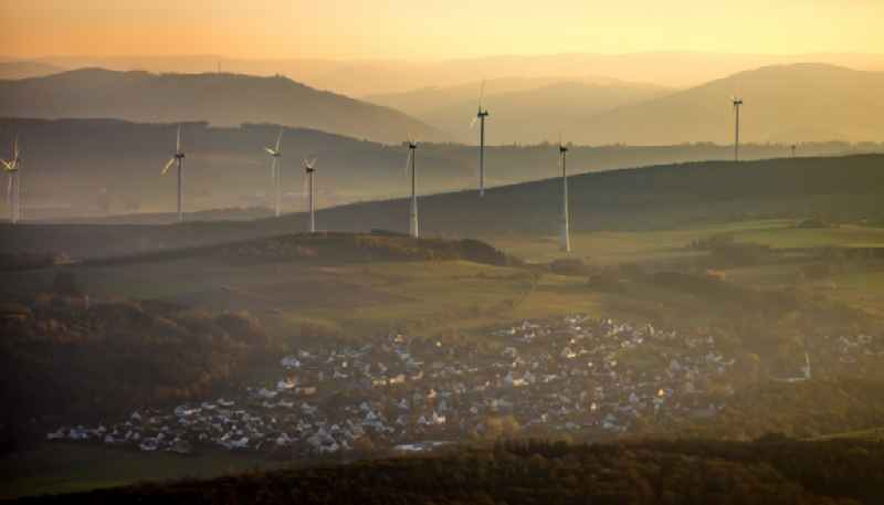 City view von Scharfenberg with silhouette of a group of wind power plants in the district Scharfenberg in Brilon in the state North Rhine-Westphalia, Germany.
