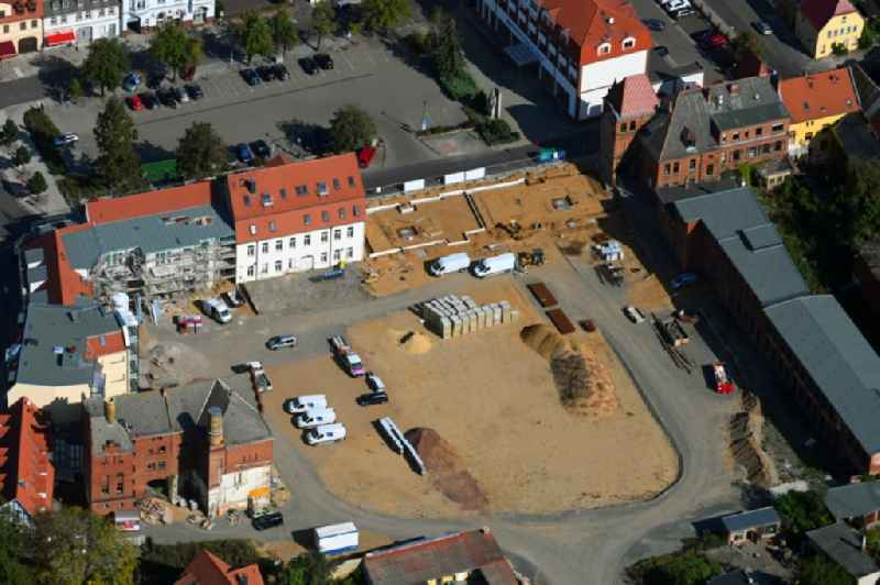Construction site for the new residential and commercial building on Bruederstrasse in Burg in the state Saxony-Anhalt, Germany
