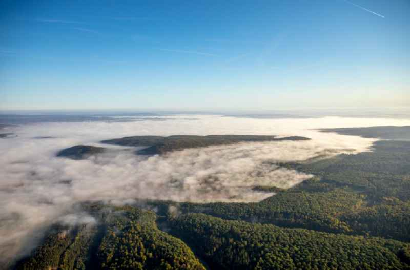 Weather with layered fog cover at a forest area in Dassel in the state Lower Saxony, Germany.