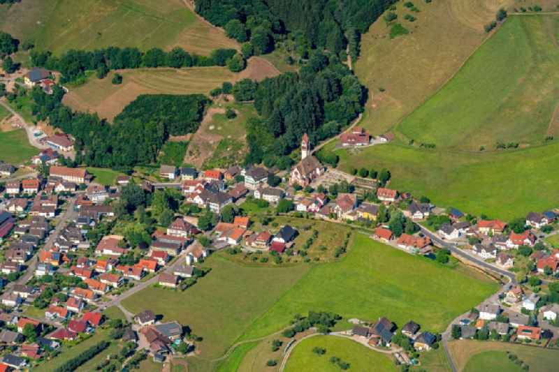 Location view of the streets and houses of residential areas in the valley landscape surrounded by mountains in Doerlinbach in the state Baden-Wuerttemberg, Germany