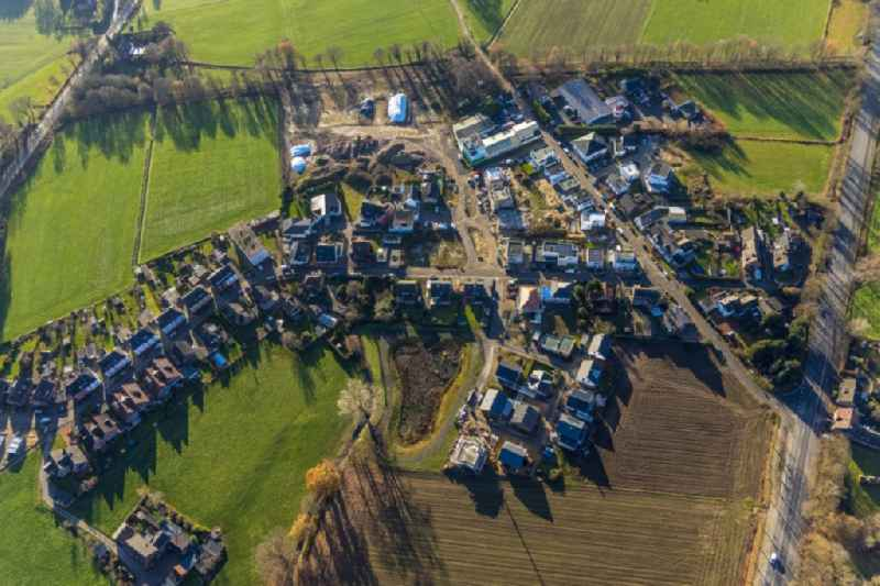 Construction sites for new construction residential area of detached housing estate Auf dem Beerenkamp - Schwickingsfeld in Dorsten in the state North Rhine-Westphalia, Germany
