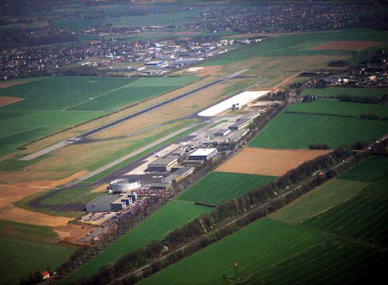 Runway with hangar taxiways and terminals on the grounds of the airport in Dortmund in the state North Rhine-Westphalia, Germany. Further information at: Flughafen Dortmund GmbH.