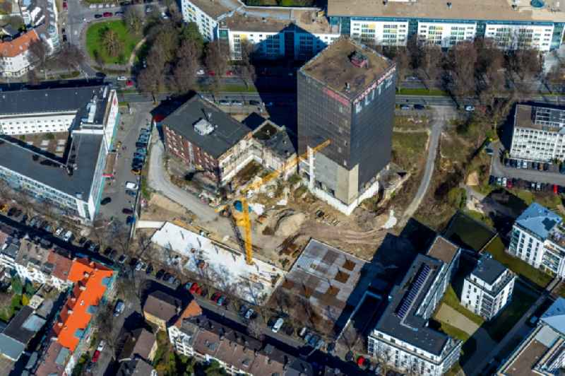 Construction site on the site of the industrial ruin 'Kronenturm' of the former Kronen brewery for the construction of a residential building for rental apartments with underground parking on the Kronenstrasse in Dortmund in the state North Rhine-Westphalia, Germany