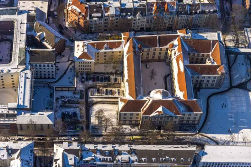 Wintry snowy court- Building complex of 'Amtsgericht Dortmund' on Gerichtsstrasse in the district Kaiserbrunnen in Dortmund at Ruhrgebiet in the state North Rhine-Westphalia, Germany
