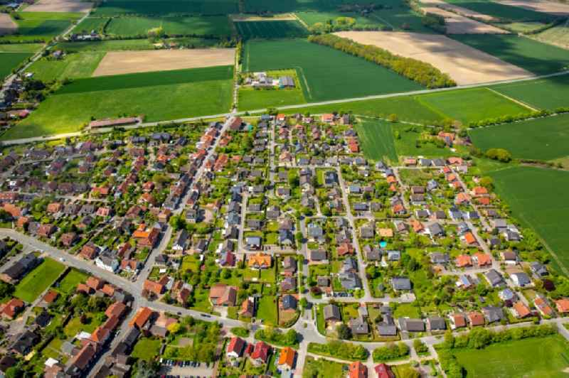 Single-family residential area of settlement on Brink - Kastanienweg in Drensteinfurt in the state North Rhine-Westphalia, Germany.