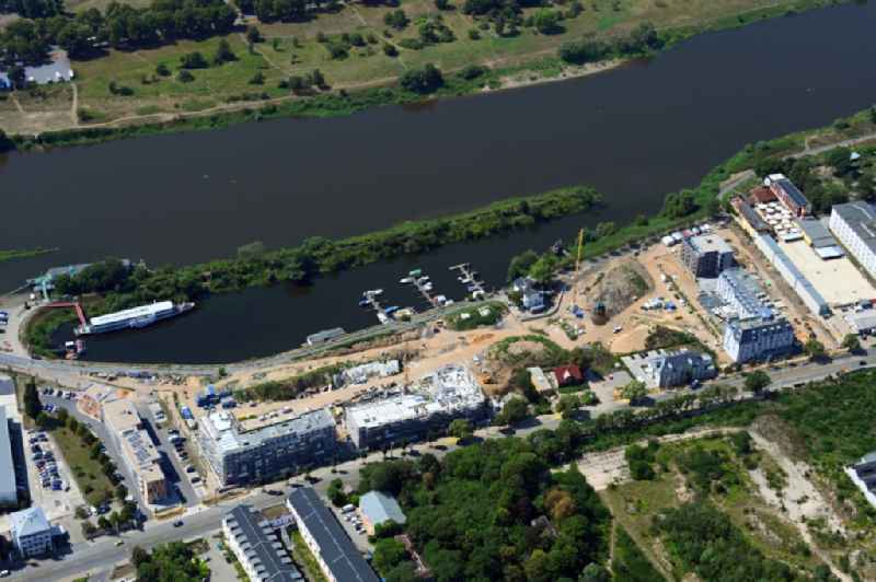 Construction site to build a new multi-family residential complex ' HAFENCITY Dresden ' on Elberadweg in Dresden in the state Saxony, Germany