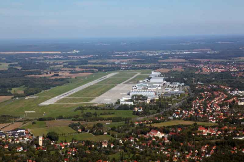 Runway with hangar taxiways and terminals on the grounds of the airport in the district Klotzsche in Dresden in the state Saxony, Germany