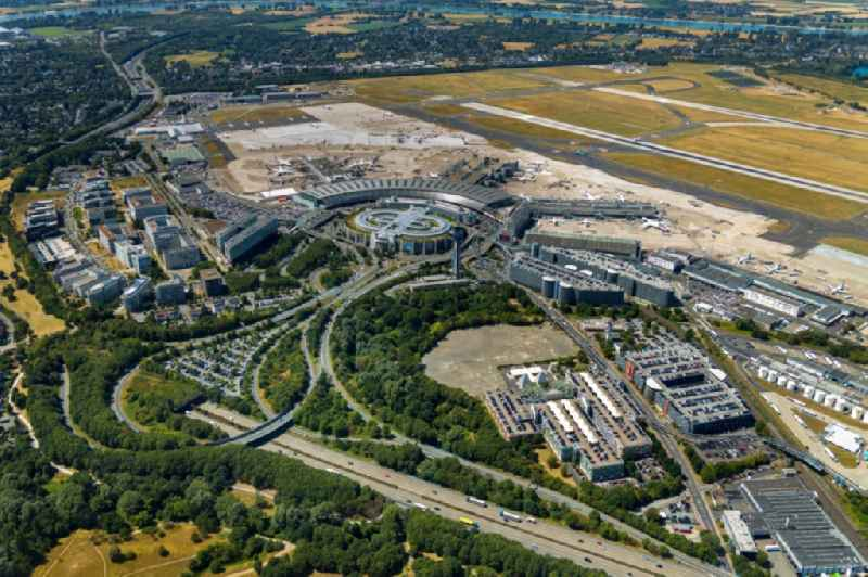 Runway with hangar taxiways and terminals on the grounds of the airport in Duesseldorf in the state North Rhine-Westphalia, Germany