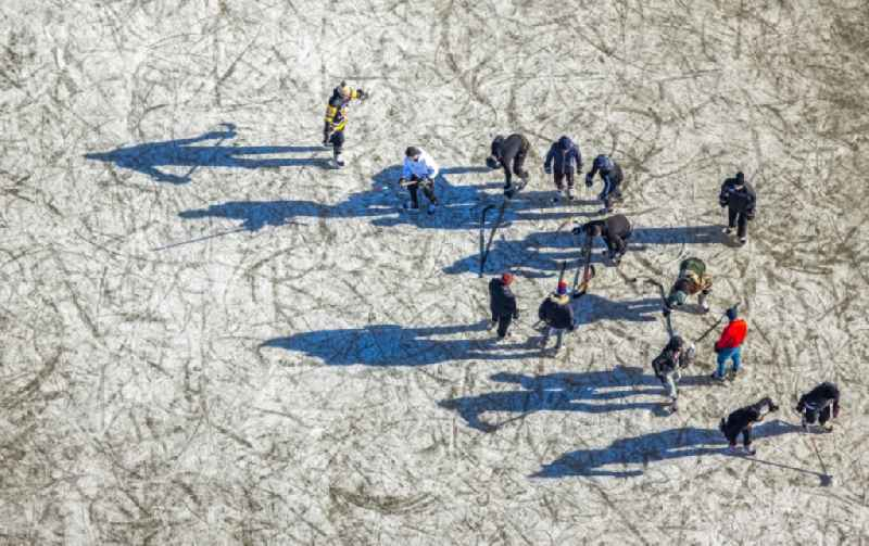 Walkers and passers-by walk on the ice sheet of the frozen bank areas in the course of the river of the Rhine river in the district Ehingen in Duisburg at Ruhrgebiet in the state North Rhine-Westphalia, Germany