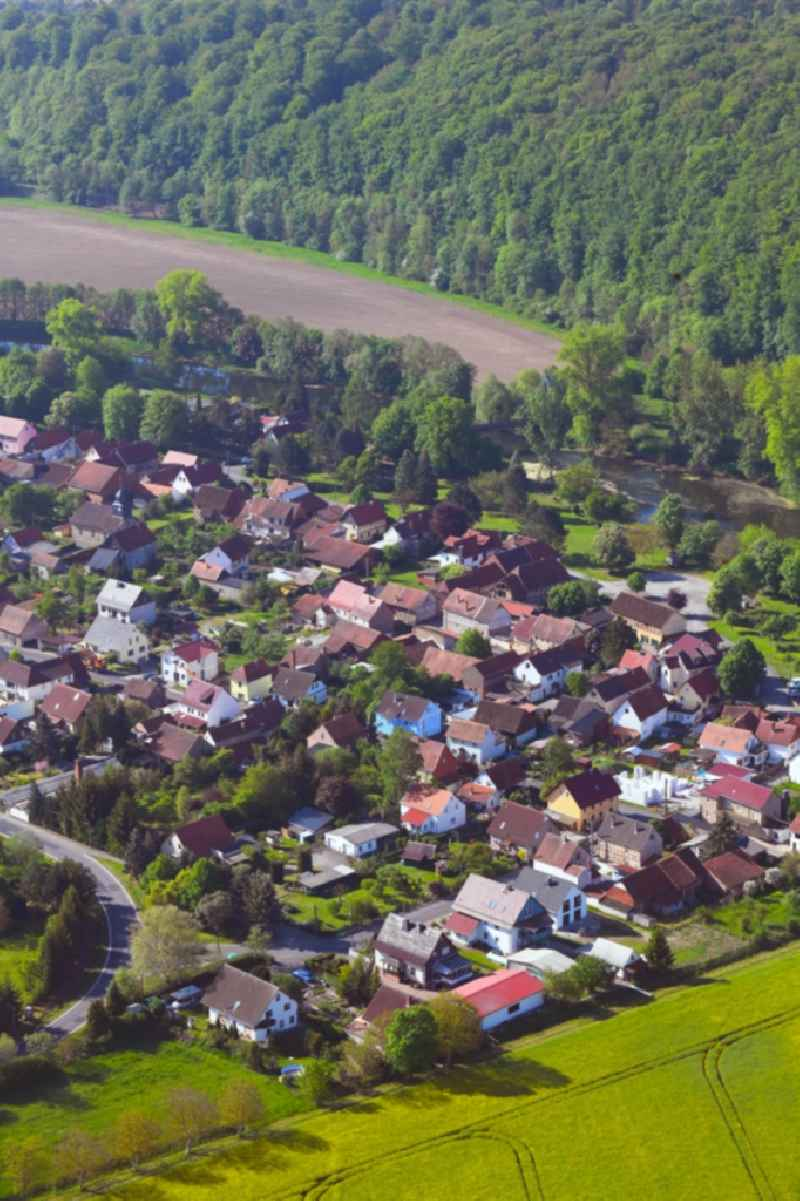 Surrounded by forest and forest areas center of the streets and houses and residential areas in Ebenshausen in the state Thuringia, Germany