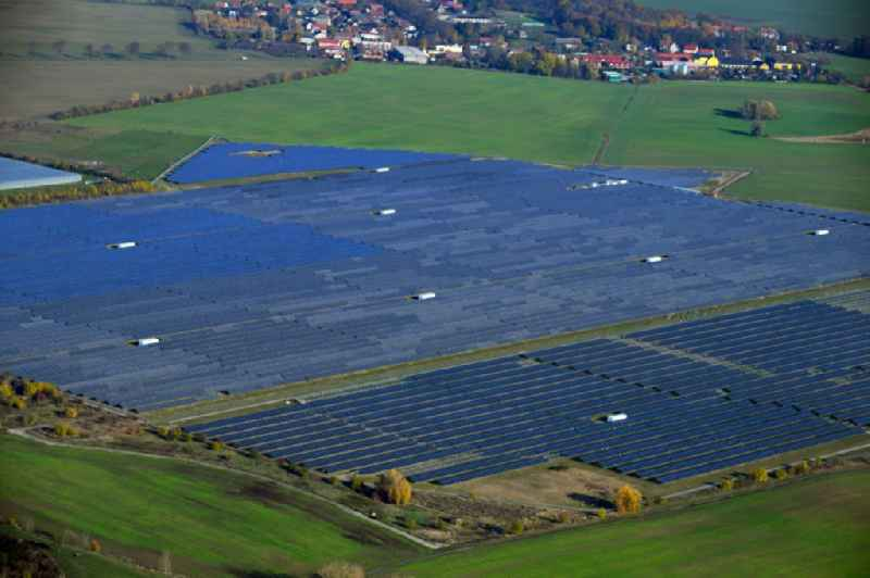 Panel rows of photovoltaic and solar farm or solar power plant on fields in Eiche in the state Brandenburg, Germany