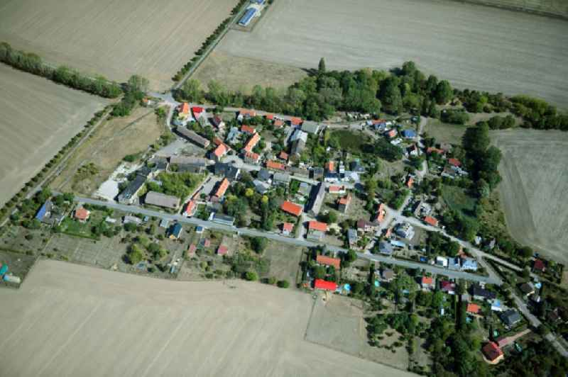 Agricultural land and field borders surround the settlement area of the village in Eismannsdorf in the state Saxony-Anhalt, Germany