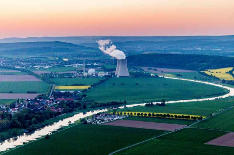 Building remains of the reactor units and facilities of the NPP nuclear power plant Grohnde on the river Weser during sunset in Grohnde in the state Lower Saxony, Germany. Further information at: RWE AG.
